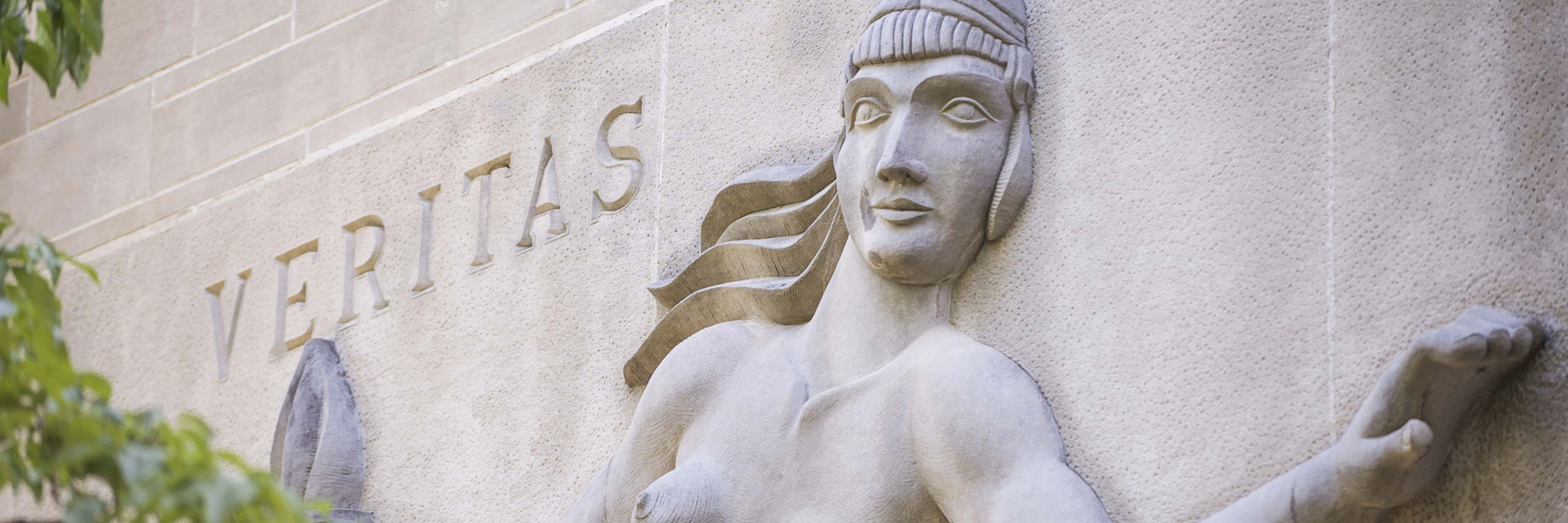 Sculpture of a woman in the side of a building
